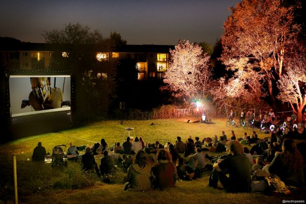 A landscape shot of a late night, outdoor film screening