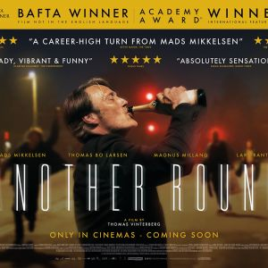 film poster, central image of Mads Mikkelsen drinking a bottle of champagne with it in the air and his eyes closed. the backgrounds of a blurred street.