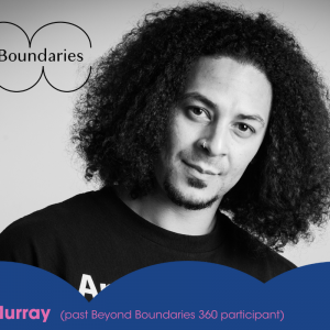headshot of Adam Murray. black and white image, he smiles at the camera. he has large afro hair and wears a black t shirt. the beyond boundaries logo sits top left, and the bottom quarter of the image has a bumpy blue